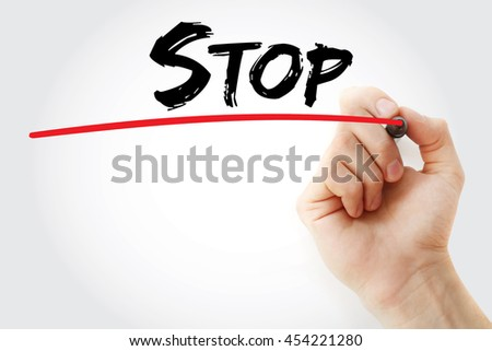 Hand writing Stop with marker, concept background - stock photo