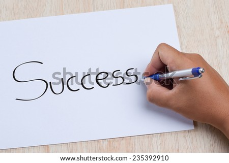 Hand writing succsess on paper - stock photo
