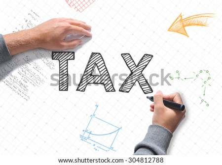 Hand writing TAX on white sheet of paper - stock photo