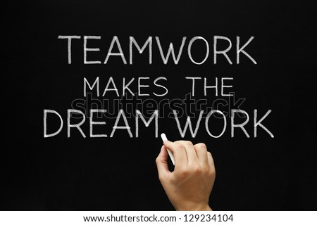 Hand writing Teamwork Makes The Dream Work with white chalk on a blackboard. - stock photo