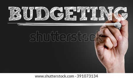 Hand writing the text: Budgeting - stock photo