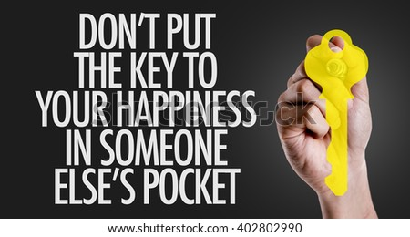 Hand writing the text: Don't Put The Key to Happiness in Someone Else's Pocket - stock photo