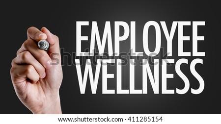 Hand writing the text: Employee Wellness - stock photo