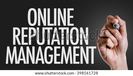 Hand writing the text: Online Reputation Management - stock photo