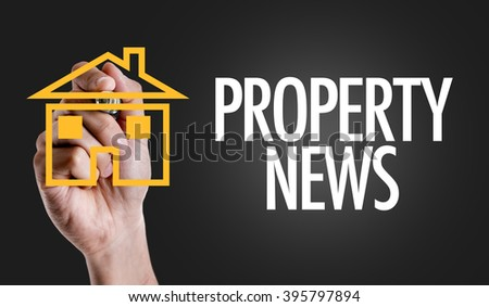 Hand writing the text: Property News - stock photo