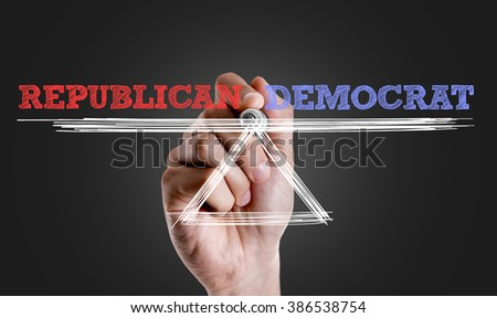 Hand writing the text: Republican x Democrat - stock photo