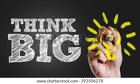 Hand writing the text: Think Big - stock photo