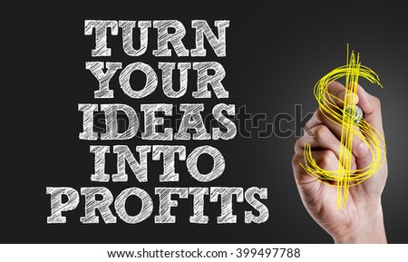 Hand writing the text: Turn Your Ideas Into Profits - stock photo