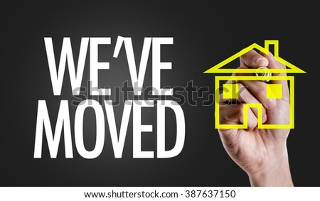 Hand writing the text: We've Moved - stock photo