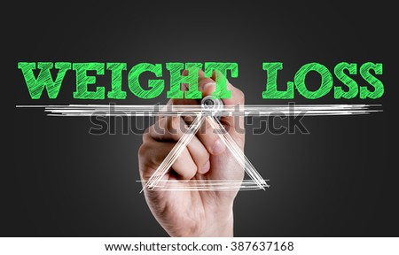 Hand writing the text: Weight Loss - stock photo