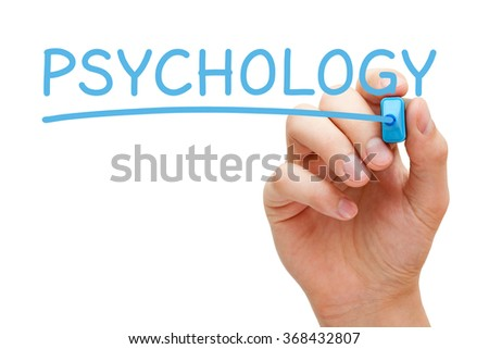Hand writing the word Psychology with blue marker on transparent wipe board.