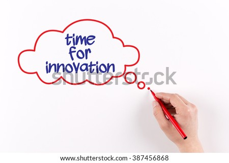 Hand writing Time For Innovation on white paper, view from above - stock photo