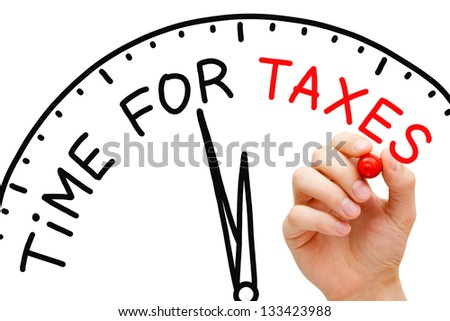 Hand writing Time for Taxes concept with red marker on transparent wipe board. - stock photo