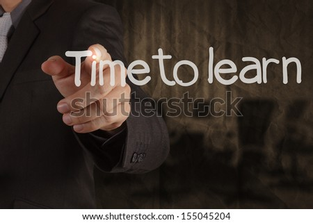 hand writing Time to Learn with meeting room on crumpled recycle paper background as concept  - stock photo