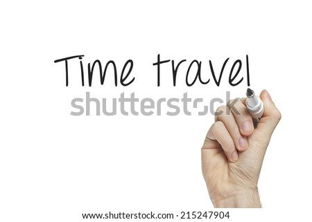 Hand writing time travel on a white board - stock photo