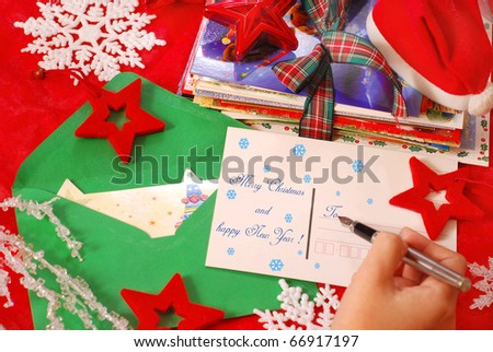 hand writing traditional greeting cards for christmas to family or friends