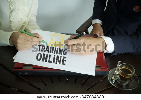 hand writing Training Online text with two business person , business concept  - stock photo