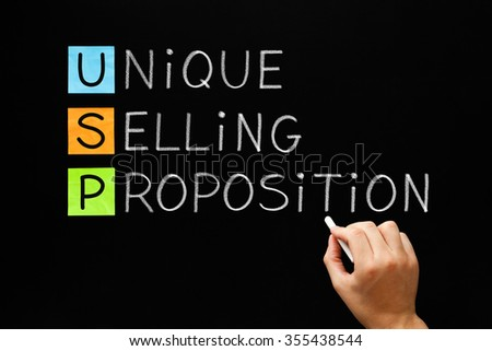 Hand writing USP Unique Selling Proposition with white chalk on a blackboard.  - stock photo
