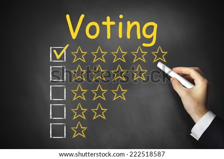 hand writing voting on blackboard