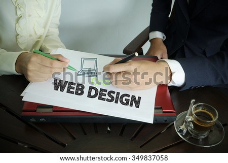 hand writing WEB DESIGN text with two business person , team work concept - stock photo