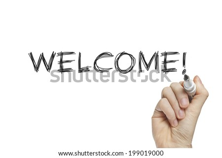Hand writing welcome on a white board - stock photo