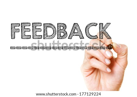 Hand writing with a black mark on a transparent board - Feedback - stock photo