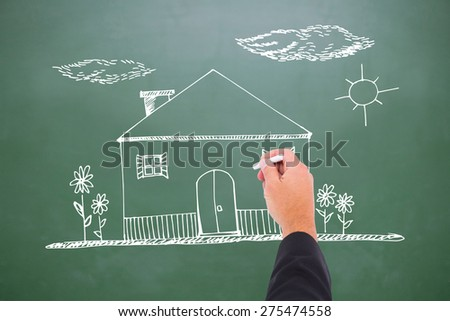 Hand writing with chalk against green chalkboard - stock photo