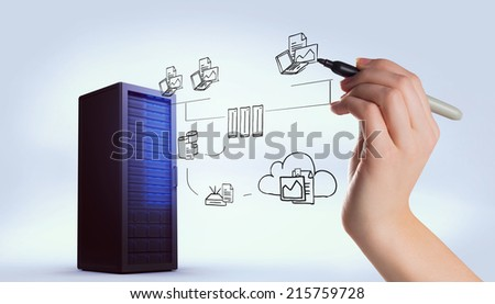 Hand writing with marker against digitally generated black server tower - stock photo