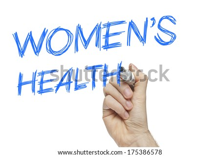 Hand writing women's health on a white board - female issues concept - stock photo