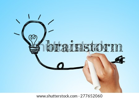 hand writing word of brainstorm with lightbulb background