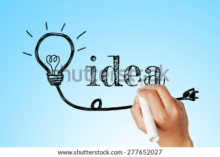 hand writing word of idea with lightbulb background