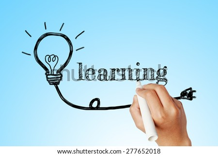 hand writing word of  learning with lightbulb background