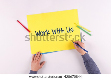 Hand writing Work With Us on yellow paper - stock photo