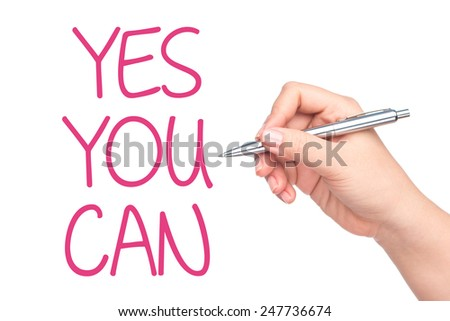 Hand writing Yes You Can words, written by hand and hand holding pen on transparent wipe board - stock photo