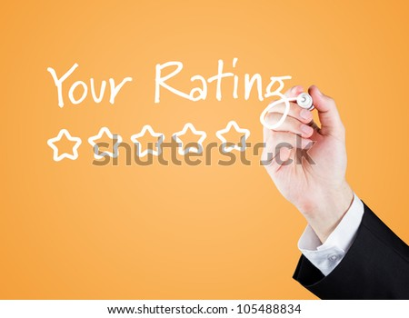 "Hand writing ""Your Rating"" to the screen. - stock photo"