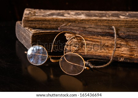 Hand Written Ancient Treatise with ancient glasses - stock photo