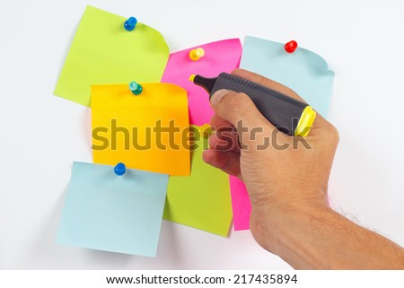 Hand written notes a yellow marker on a red sticker on a white board from notice - stock photo