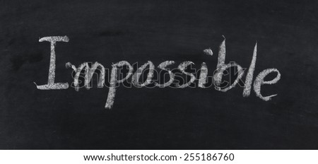 hand written word impossible with chalk on blackboard - stock photo