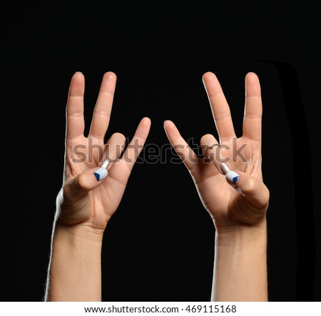 Hand yoga show Prithvi Mudra or the Mudra of Earth on a black background
