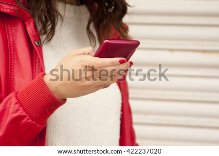 hand young girl with mobile phone