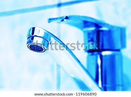 Handbasin in blue tone. Macro image. - stock photo
