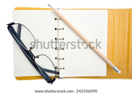 Handbook and Pencil for older person to write note - stock photo