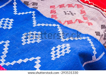 Handcraft fabric and souvenir selling on the street in the local market in Morocco - stock photo