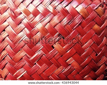 Handcraft weave texture natural wicker. Red abstract pattern background. - stock photo