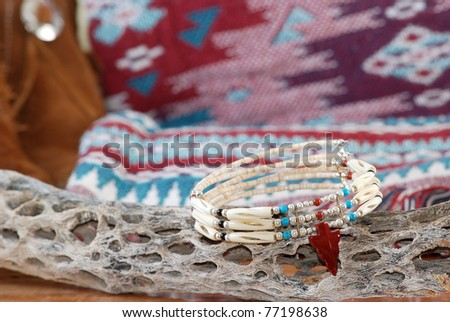 Handcrafted bead and bone Native American Choker Necklace in Southwester Still Life setting with Indian Blanket, Moccasins and an old stick of dried cholla cactus. - stock photo