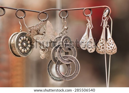 handcrafted Chinese jewelry on Panjiayuan Market, located in south east Beijing, China. - stock photo
