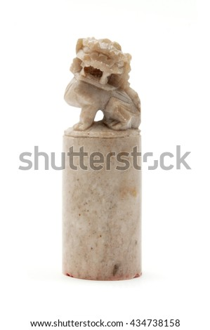 Handcrafted chinese lion seal on a white background