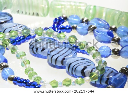 Handcrafted necklaces made from glass beads - stock photo