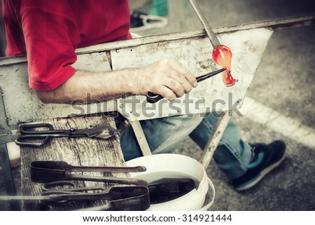 Handcrafted of glass blowing. Ancient craft for production of of glassware. - stock photo