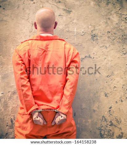 Handcuffed Prisoner waiting for Death Penalty - stock photo
